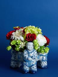 red and green floral in blue and white man vase